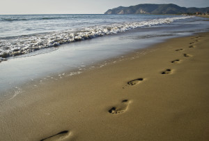 Walking footprints on the beach, concept of summer, vacations, fun
